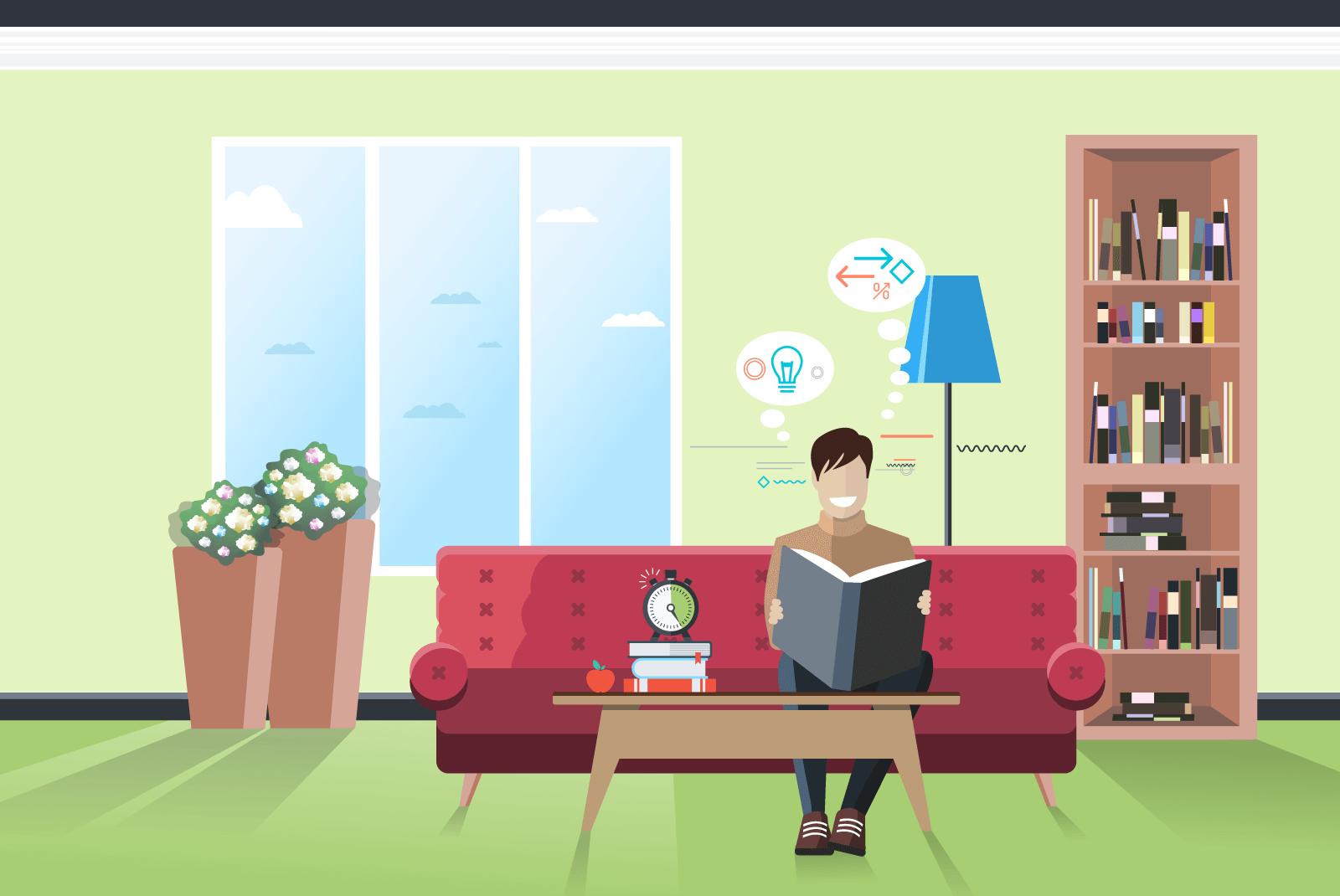 Ein Mann sitzt lesend und lernend auf einer couch