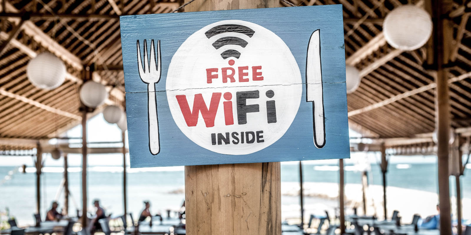 A sing with free wifi on it in a restaurant
