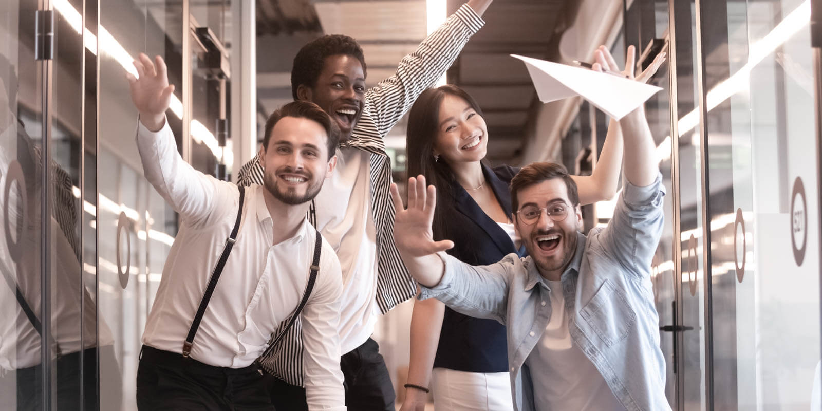 Four people are happy in the office